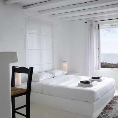 white minimal double bedroom