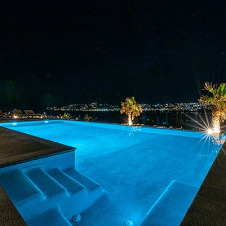 the pool area with lights during night time