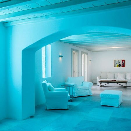 house  with blue light from the pool