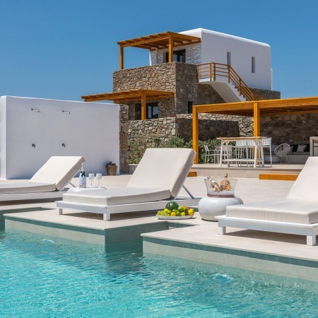 pool and sun beds closeup