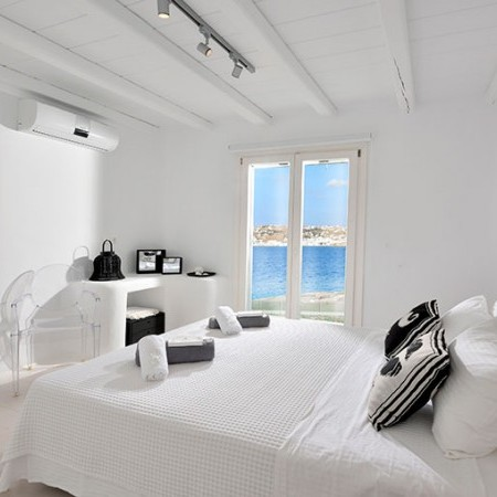 double bedroom with glass windows