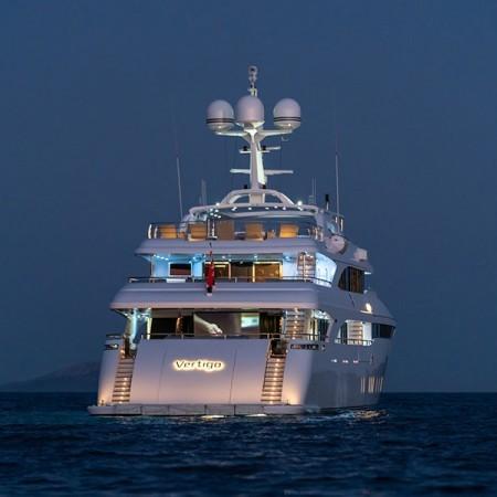 Vertigo Yacht at night