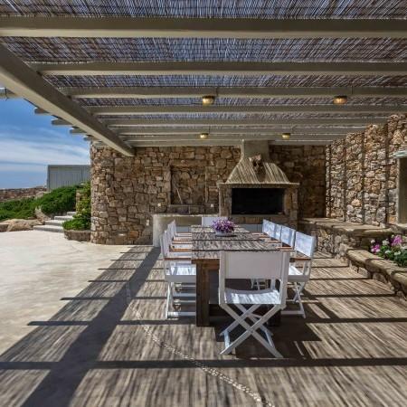 exterior dining area with pergola shade