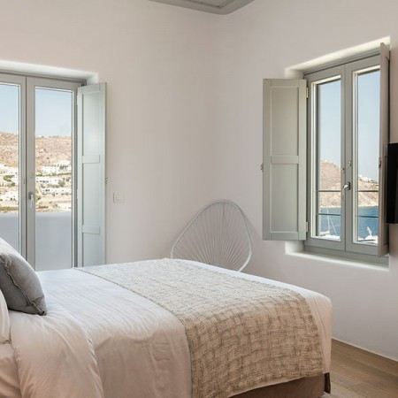bedroom with window and balcony