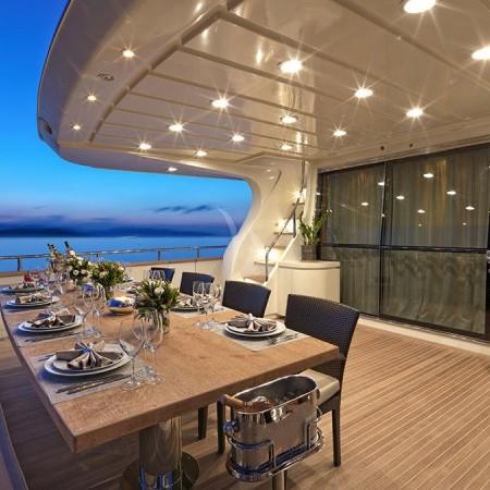 Celia yacht dining at night