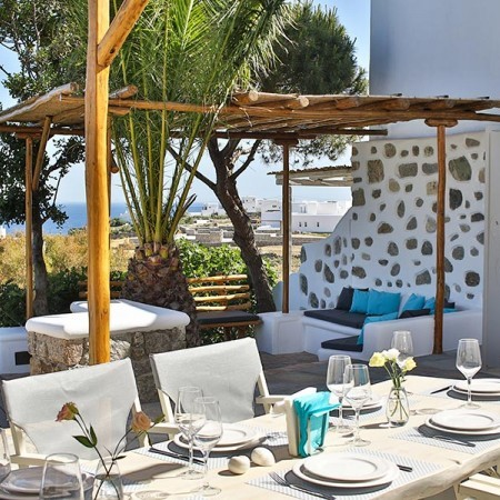 Outdoor lounge area at villa in Mykonos