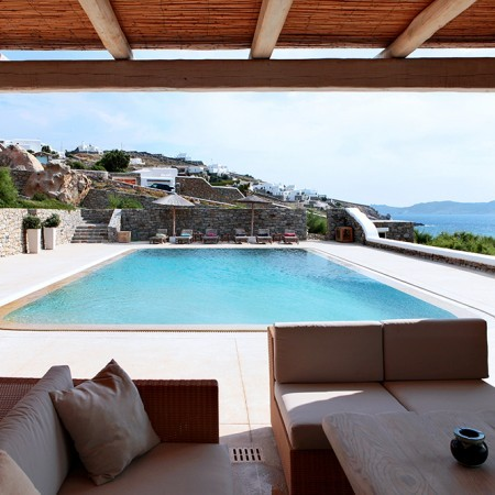 outdoor lounge with pool view