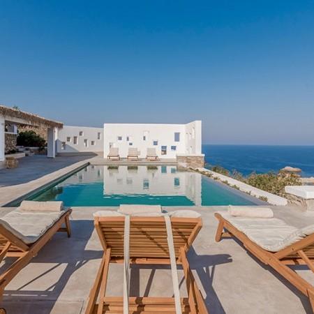 pool accompanied by sun beds