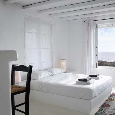 white minimal double bedroom
