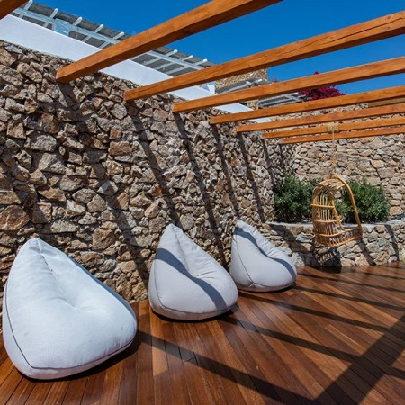 pouf chairs on the deck at villa Afitis in Mykonos