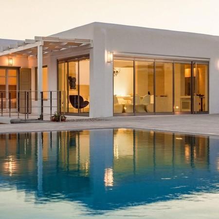 the villa lights and pool at night