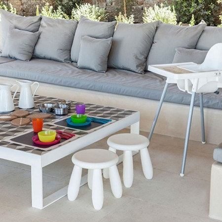 outdoor dining area with sofas
