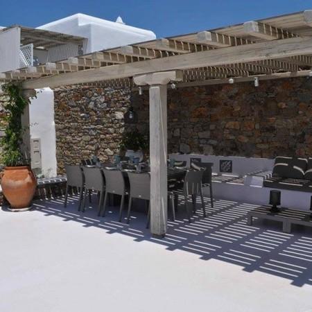 pergola shaded outdoor dining area