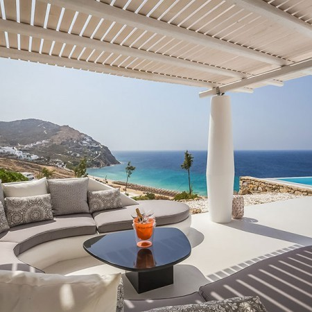 outdoor living area with pool and sea view