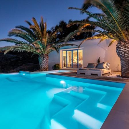 whispering palms villa at night
